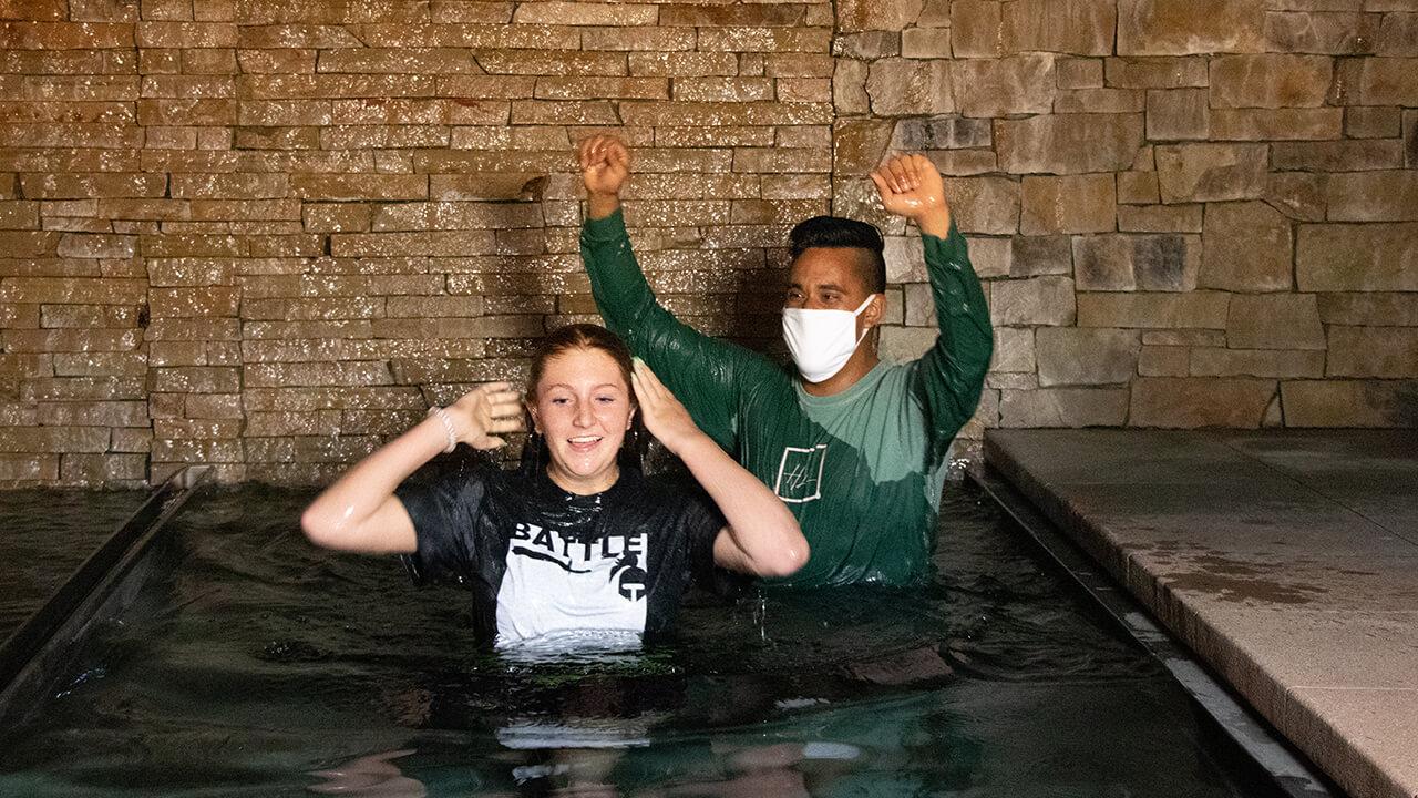 Pastor Alec Alvarado Baptizing a Female Youth Ministry Student